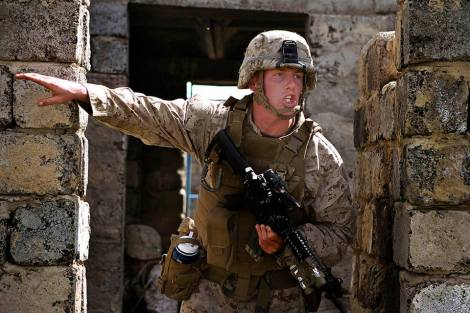 U.S. Marine Lance Cpl. Nicholas Moore shouts orders to his team during a training exercise Aug. 8. (U.S. Marine Corps photo by Cpl. Robert Bush)