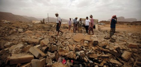 Tribesmen stand on the rubble of a building destroyed by a U.S. drone strike that targeted suspected al-Qaeda militants in the southeastern Yemeni provence of Shabwa on February 3, 2013. (Khaled Abdullah/Reuters/Corbis)