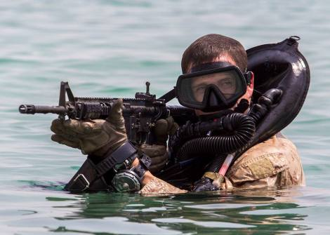 A U.S. Marine assigned to the 26th Marine Expeditionary Unit provides security while conducting training with foreign Marines in the U.S. Central Command area of responsibility Sept. 1. (U.S. Marine Corps photo by Sgt. Christopher Q. Stone, 26th MEU Combat Camera)