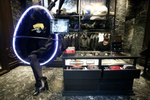 Photographer: Alessia Pierdomenico/Bloomberg An employee adjusts a display inside a Moncler luxury skiwear store, operated by Moncler SpA, in Milan.